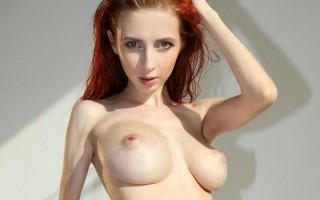 Helga Grey showing her big tits in her studio