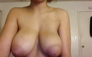Big titted ebony cam girl shows off