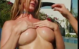 Lesbians use dildo by the pool