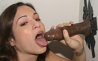 Amber Rayne sucks off black in pornshop gloryhole
