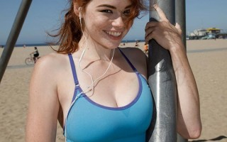 Big titty redhead Sabrina Lynn exercising in the beach