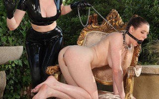 Latex Lucy Crams Samantha Bentley's Ass With A Silver Plug