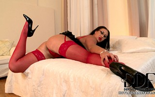 Emma gets ultra sexy on the bed with sinful red stockings